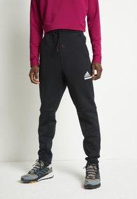 adidas Performance - SPORTSWEAR AEROREADY PANTS - Teplákové kalhoty - black - 0