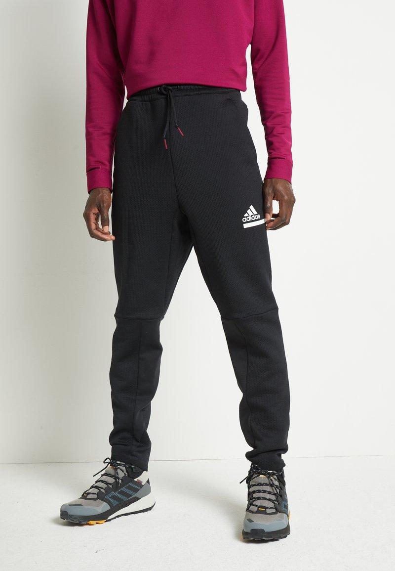 adidas Performance - SPORTSWEAR AEROREADY PANTS - Teplákové kalhoty - black