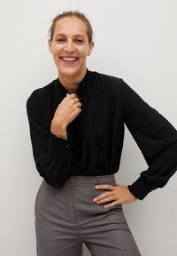 Mango - CACHITO - Button-down blouse - černá - 4