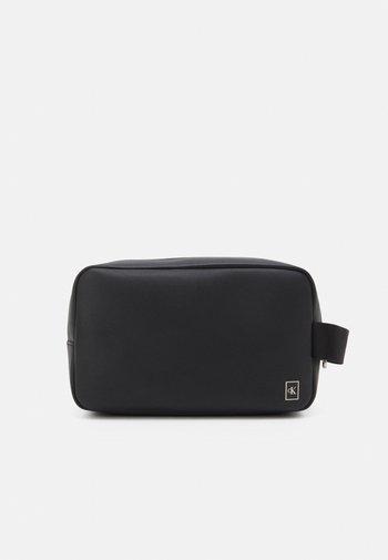 SLIM WASHBAG UNISEX - Wash bag - black