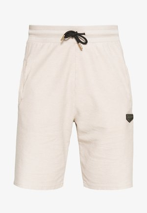 LOOPER - Pantalones deportivos - sand