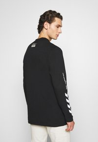 Hummel Hive - SUBURB UNISEX - Long sleeved top - black - 2
