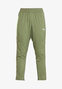 Puma - ENERGY PANT - Pantalon de survêtement - olivine/yellow - 4