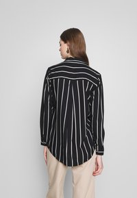 ONLY - ONLFREYA  - Button-down blouse - black/cloud dancer - 2