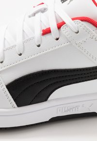 Puma - REBOUND LAYUP UNISEX - Sneakers - white/black/high risk red - 5