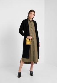 pure cashmere - LONG CARDIGAN - Vest - black - 1