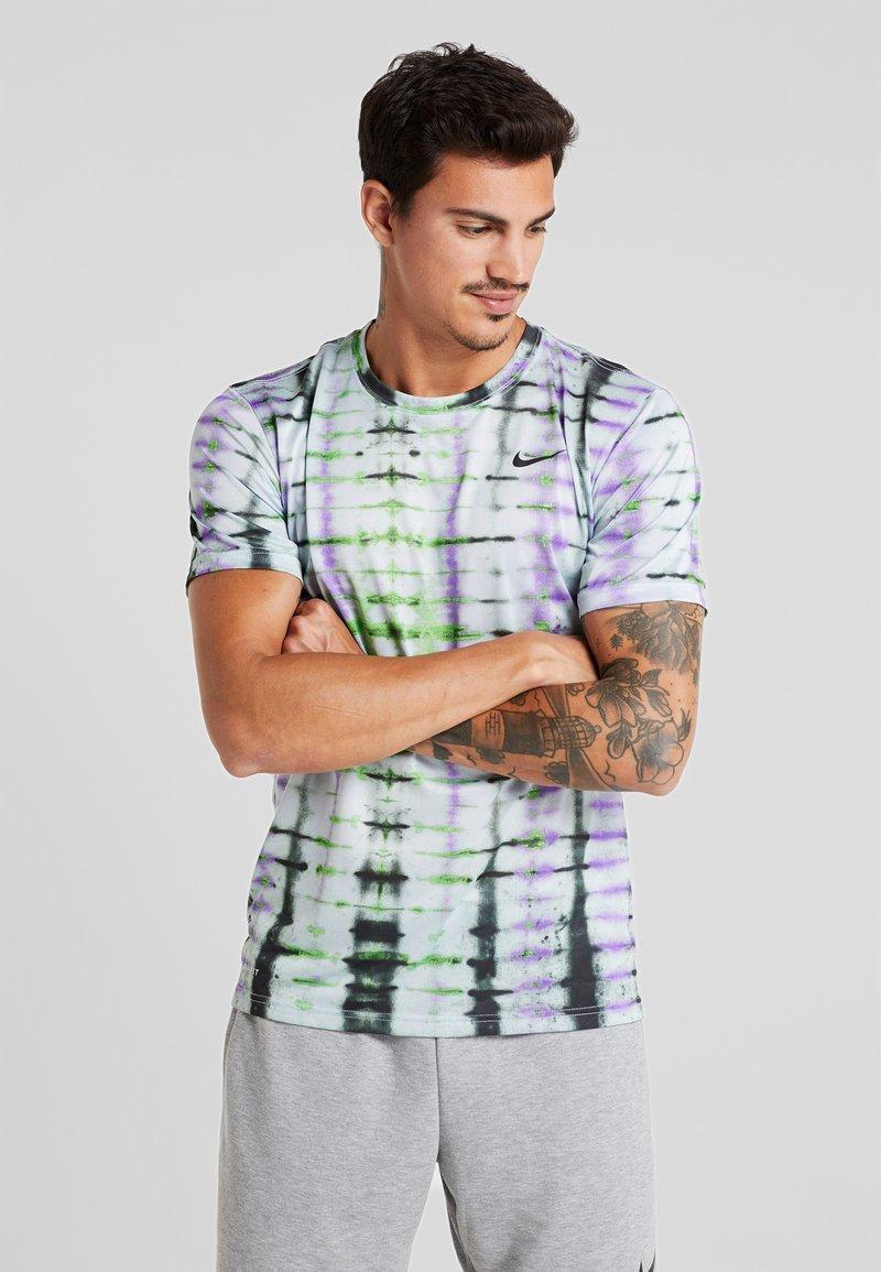 Nike Performance - LEGEND TEE NATURAL HIGH - T-Shirt print - ghost