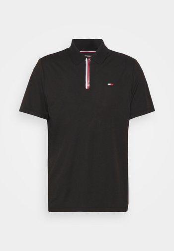 STRIPE TRAINING - Polo shirt - black
