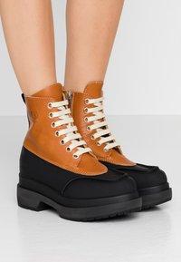 MM6 Maison Margiela - Platform ankle boots - bran/black - 0