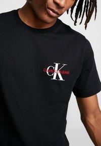 Calvin Klein Jeans - MONOGRAM EMBRO CHEST - Print T-shirt - black - 5