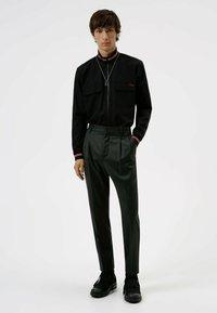 HUGO - Trousers - dark grey - 1
