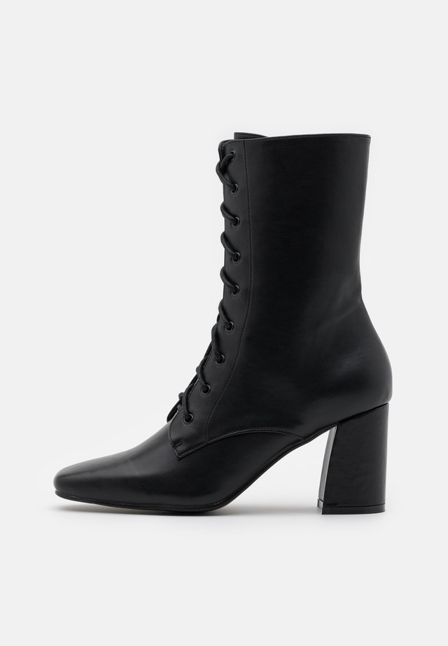 AVRI - Lace-up ankle boots - black