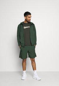 Nike Performance - DRY HOODIE  - Zip-up hoodie - galactic jade/black - 1