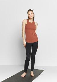 Nike Performance - W NK YOGA LUXE RIB TANK - Top - red bark/terra blush - 1
