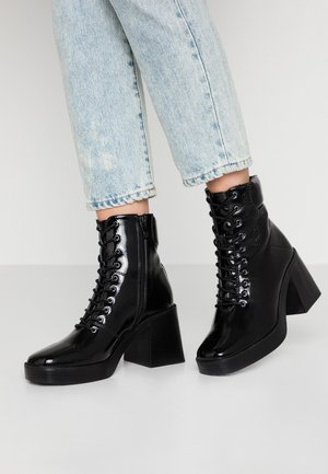CORINNE - High heeled ankle boots - black