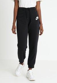 Nike Sportswear - RALLY - Tracksuit bottoms - black - 0