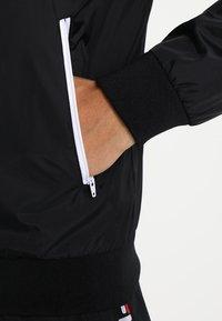 Urban Classics - Light jacket - black/white - 4