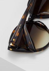 Alexander McQueen - Lunettes de soleil - brown - 4