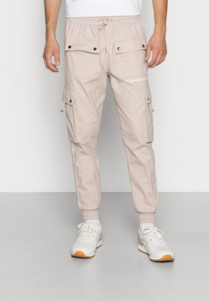 DEFINITION PIPED PANT - Cargo trousers - stone