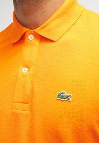 Lacoste - Polo shirt - mango chine - 4