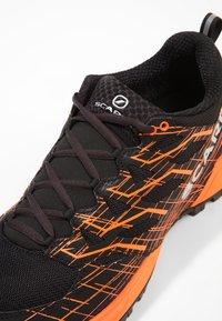 Scarpa - NEUTRON 2 - Trail running shoes - black/orange - 5
