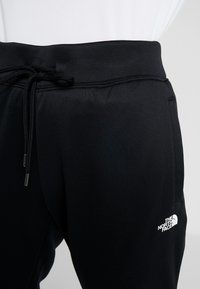 The North Face - SURGENT CUFFEDPANT - Tracksuit bottoms - black - 4