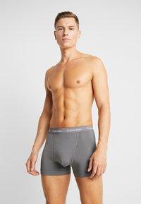 Calvin Klein Underwear - TRUNK 3 PACK - Pants - blue - 1