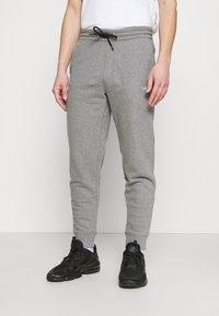 Calvin Klein - SMALL LOGO - Tracksuit bottoms - grey - 0