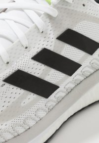 adidas Performance - SOLAR GLIDE BOOST SHOES - Zapatillas de running neutras - footwear white/core black/signal green - 5