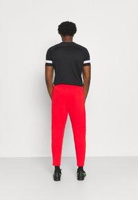 Nike Performance - LIVERPOOL FC PANT - Squadra - rush red/black - 2
