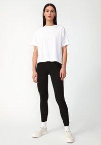 ARMEDANGELS - FARIBAA - Leggings - Trousers - black - 1