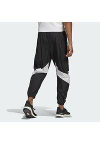 adidas Performance - Tracksuit bottoms - black/black - 1