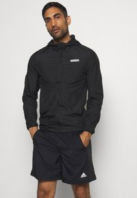 Jack & Jones Performance - JCOZSPORT JACKET - Training jacket - black - 0