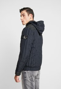 Calvin Klein Jeans - PADDED HOOD ZIP THROUGH - Light jacket - black - 3