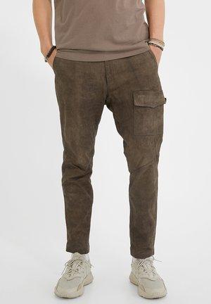 ARIS TAHARI - Leather trousers - rails