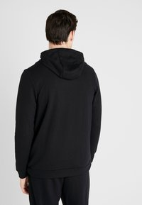 Nike Performance - DRY HOODIE - Jersey con capucha - black - 2