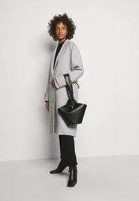 Little Liffner - SOFT LOOP MINI BUCKET - Handbag - black - 0