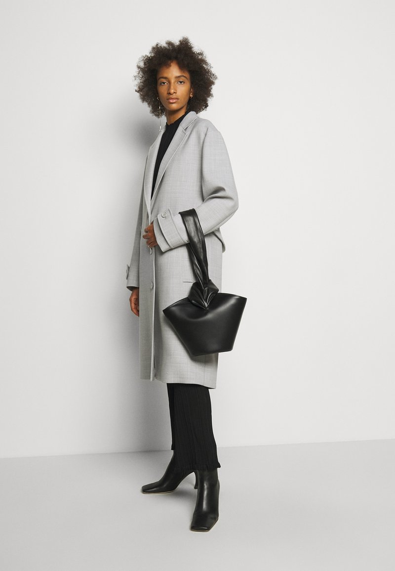 Little Liffner - SOFT LOOP MINI BUCKET - Handbag - black