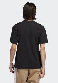 adidas Originals - MANOLES ALIAS T-SHIRT - Print T-shirt - black - 1