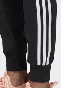 adidas Performance - ESSENTIALS 3-STRIPES JOGGERS - Pantalones deportivos - black - 3