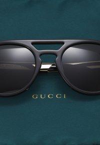 Gucci - Occhiali da sole - black/gold-coloured/grey - 2
