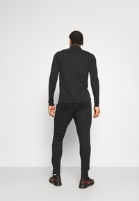 Nike Performance - ACADEMY 21 PANT - Tracksuit bottoms - black - 2