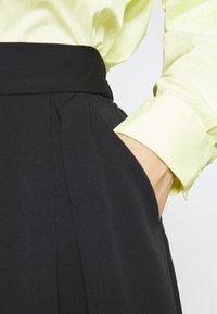 Monki - SIGRID BUTTON SKIRT - A-line skirt - black dark solid - 3