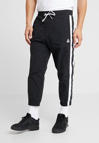 Reebok - MEET YOU THERE TRAINING 7/8 JOGGER PANTS - Tracksuit bottoms - black - 0