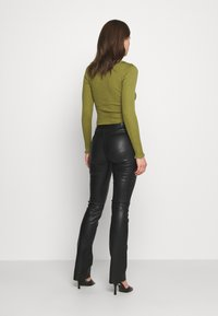 Ibana - LUCILLE - Leather trousers - black - 2