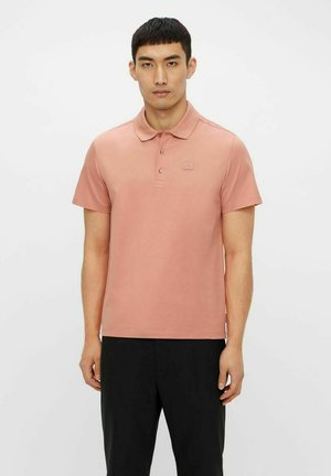 MILES  - Polo shirt - rose coppar