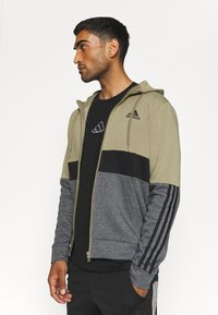 adidas Performance - COLORBLOCK FULL ZIP ESSENTIALS - Zip-up sweatshirt - orbit green/black - 3