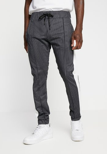 RAIN - Pantaloni sportivi - black/white
