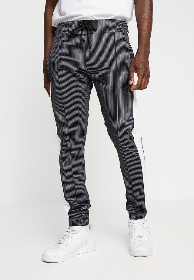RAIN - Pantalon de survêtement - black/white