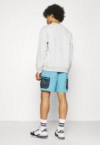 adidas Originals - UNISEX - Shorts - hazy blue - 2